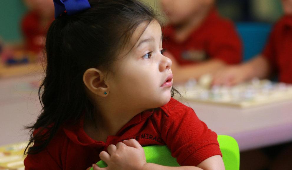 little girl wearing blue ribbon